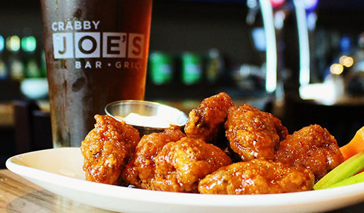 crabby joes sauced wings and glass of cola
